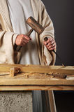 Jesus Hands With Mallet and Chisel. Jesus with mallet and chisel working in workshop Royalty Free Stock Photo