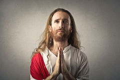 Jesus with hands praying. Jesus in a praying position with hands together Stock Photography