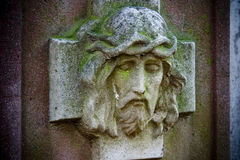 Jesus' Head. A stone carving or sculpture of the head of Jesus on a cross Stock Image