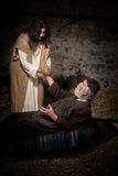Jesus healing the crippled man. Jesus healing the lame or crippled man stock image