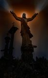 Jesus healing hands. Illuminated Jesus. Healing hands with vissible energy rays. Hill of Crosses in Lithuania royalty free stock photo