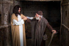 Jesus healing the lame. Or crippled man stock image