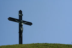 Jesus on hilltop. A cross with jesus at a hiltop royalty free stock photography