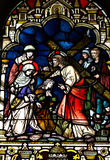 Jesus with his cross. A stained glass photo of Jesus and his cross royalty free stock photos