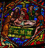 Jesus in his tomb. Stained glass window depicting Jesus brought to his tomb in the cathedral of Leon, Castille and Leon, Spain royalty free stock image