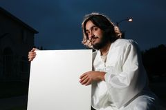 Jesus holding a blank sign royalty free stock images