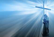 Jesus holding a cross on blue background Royalty Free Stock Images