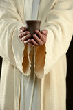 Jesus holding a cup Stock Photography