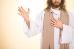 Jesus holding hand on heart. Jesus holding one hand on heart and other one up Royalty Free Stock Images