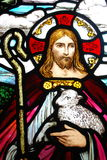 Jesus holding a lamb. Stained glass image of Jesus with a lamb Royalty Free Stock Photo