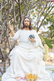 Jesus holding the world in his hand. Jesus holding the world in his left hand Royalty Free Stock Image
