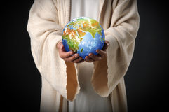 Jesus Holding the World in His Hands. Over a dark background Royalty Free Stock Images