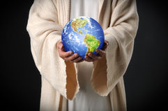 Jesus Holding World in Zijn Handen Stock Afbeelding