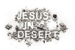 Jesus i öknen som är skriftlig i aska royaltyfria foton