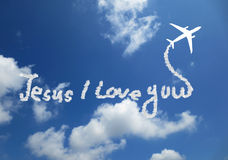 Jesus I Love You. ! text in clouds form with blue sky background royalty free illustration