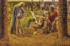 jesus josef mary för christ jullathund julkrubba Arkivfoto