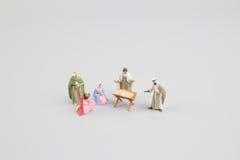 jesus josef mary för christ jullathund julkrubba Behandla som ett barn Jesus i förgrund behandla som ett barn jesus Fotografering för Bildbyråer