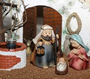 Jesus Joseph with the beard and the stick and Mary in a manger o Royalty Free Stock Images