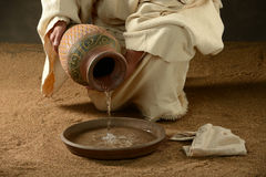 Jesus with a jug of water. And a towell on a neatral background royalty free stock photo