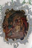 Jesus is laid in the tomb. Way of the Cross, fresco on the ceiling of the Church of Our Lady of Sorrows in Rosenberg, Germany stock image