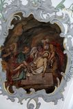Jesus is laid in the tomb, Way of the Cross. Fresco on the ceiling of the Church of Our Lady of Sorrows in Rosenberg, Germany royalty free stock photos