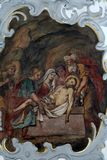 Jesus is laid in the tomb, Way of the Cross. Fresco on the ceiling of the Church of Our Lady of Sorrows in Rosenberg, Germany royalty free stock image