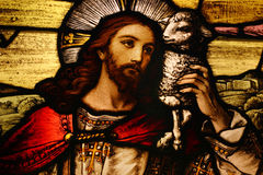 Jesus with Lamb. Stained glass depicting Jesus holding a lamb stock photography