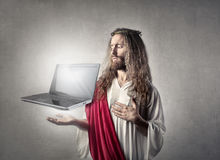 Jesus with a laptop Stock Photography