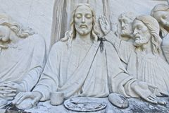 Jesus the Last Supper. Religious embossed carving out of stone of Jesus at the Last Supper royalty free stock photography