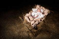 Jesus Laying on a Manger Stock Photos