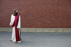 Jesus looking over his shoulder at blank wall Stock Photography