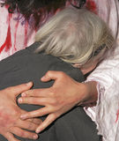 Jesus love. Jesus hands hugging an old woman Stock Image