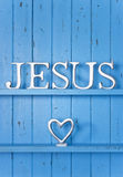 Jesus Love Background. A blue painted wood background with the word Jesus on it and a love heart Royalty Free Stock Photos