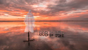 Jesus Love. Cross with a image of Jesus Christ on a beach at Sunset Royalty Free Stock Photography