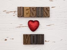 Jesus Loves You. On a distressed white wood table Royalty Free Stock Photos