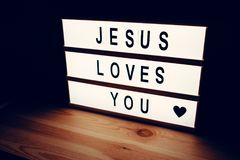 Jesus loves you. Religious message lightbox, concept of christianity and faith in God Stock Images