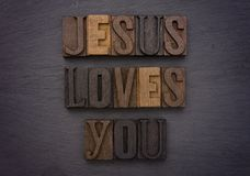 Jesus loves you. Spelled out in type set on a chalkboard Royalty Free Stock Photo
