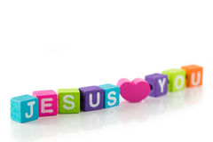 Jesus loves you. 'Jesus loves you' sign illustrated with colorful cubes Royalty Free Stock Image