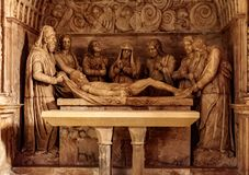 Jesus lying in the tomb. After crucifixion stock photos