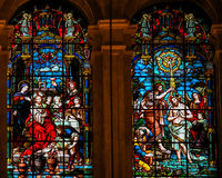 Jesus at the Marriage at Cana and Baptism by Saint John. Stained glass window depicting, on the left, Jesus at the Wedding at Cana, and, on the right, Jesus Royalty Free Stock Photography
