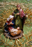 Jesus, Mary and Joseph. A crib scene. Jesus a praying Mary and Joseph surrounded by golden branches Stock Image