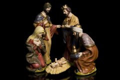 Jesus Mary and the Three Wise Men. Jesus, Mary and the Three Wise Men isolated on black Stock Images