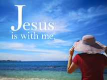 Jesus is with me with background ocean view and a lady look up to the sky design for Christianity. Read inspirational Bible verses and quotes that will stock photography