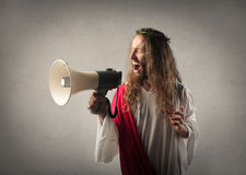 Jesus with a megaphone. Jesus shouting with a megaphone royalty free stock photography