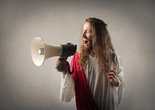 Jesus mit einem Megaphon lizenzfreie stockfotografie