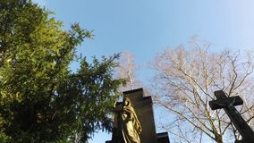 Jesus and Mother Mary Sculpture in Cemetery and Nature stock video footage