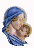 Jesus with mother. Old ceramic relief of Jesus and mother Stock Photography