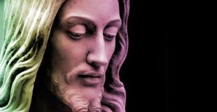 Jesus, multi-colored  copy-space. Jesus statue close-up, multi-colored photo with copy-space Stock Image