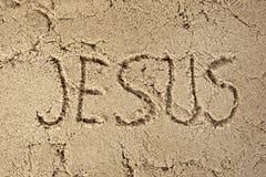 Jesus name in sand Stock Photos