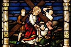 Jesus neemt Zijn kruis op Stock Fotografie
